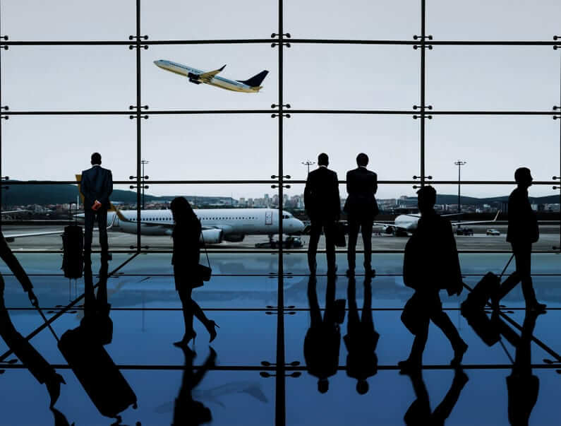Silhouette Of Group Of Business Travellers In The Interior Of Airport