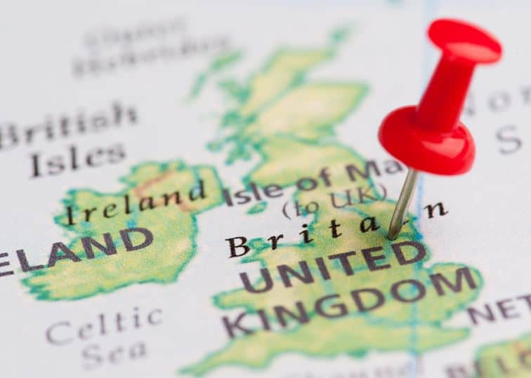 A Pin Stuck In A Map Of The United Kingdom