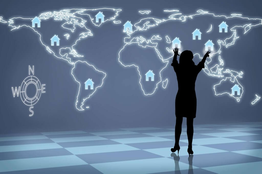 Woman In Silhouette Standing In Front Of A Map With House Icons On