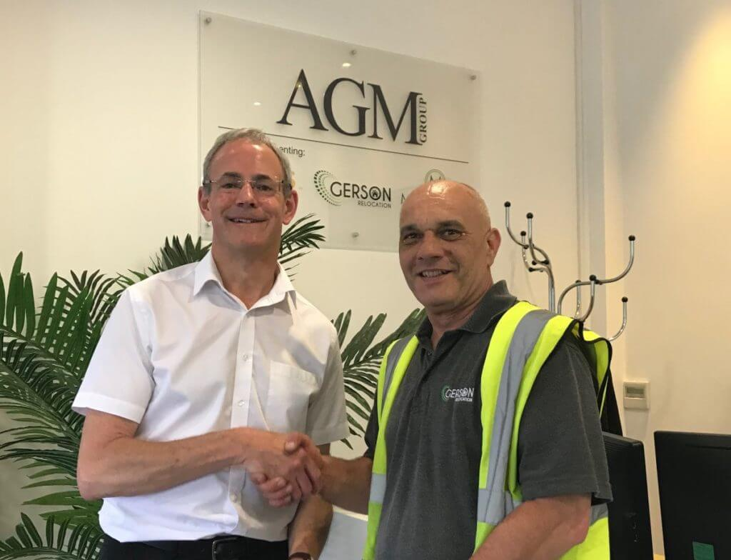 Chris Mackley And Graham Green Shaking Hands And Smiling