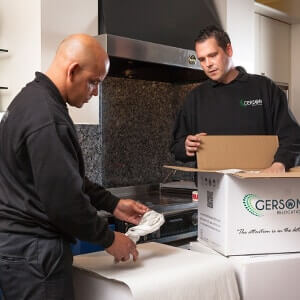 Packers packing kitchen items