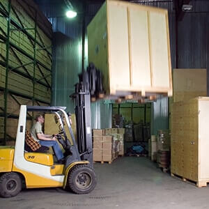 Fork-lift moving storage boxes