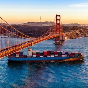 Container ship passing under San Francisco bridge