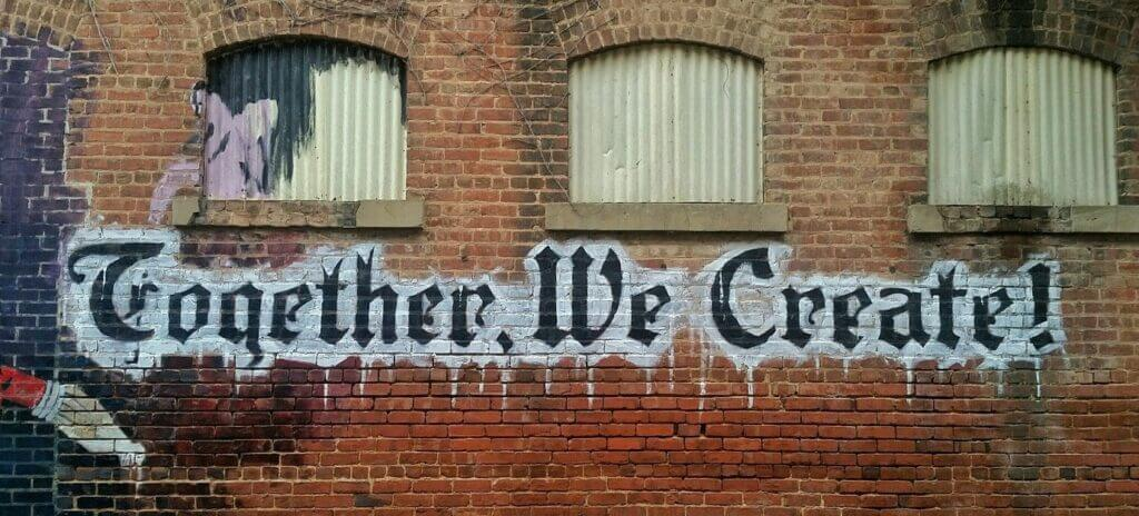 "Graffiti saying ""Together, we create"""