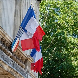 France national flags outside a historic building