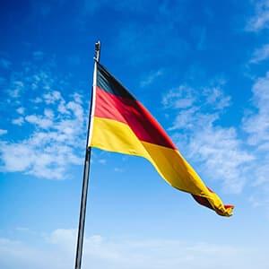 German flag against a blue sky