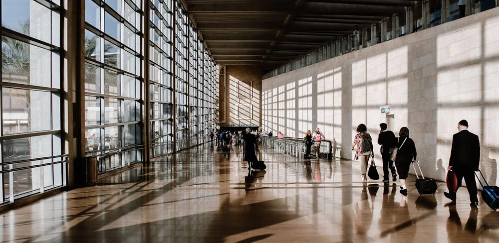 International Relocation - People Walking Through An Airport