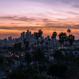 Los Angeles at sunset with houses and skyscrapers in the background