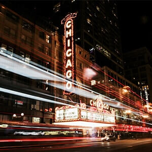 Outside view of a theatre in Chicago lit up at night