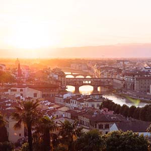 A summer evening view over the top of Florence, with a view of the chain of bridges
