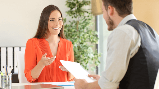 Man Interviewing A Lady In An Office Environment