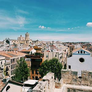 a view of Tarragona, Spain town with old architecture and blue skies